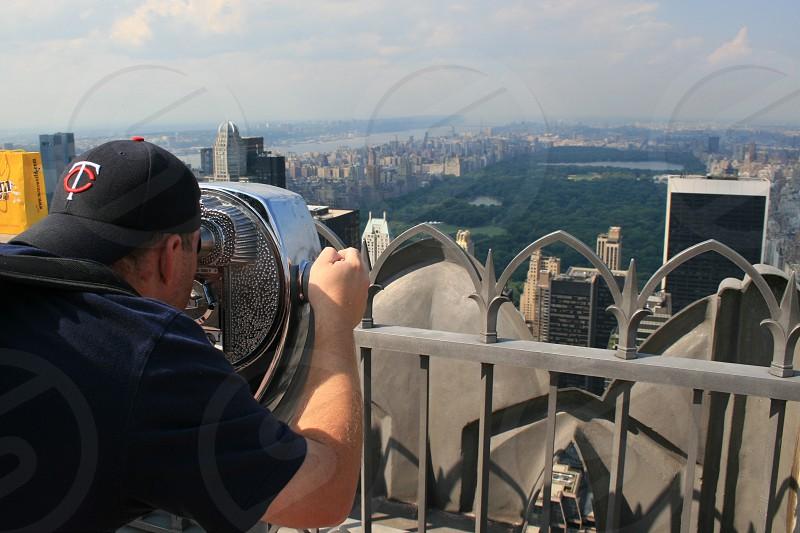 man using coin slot binocular photo