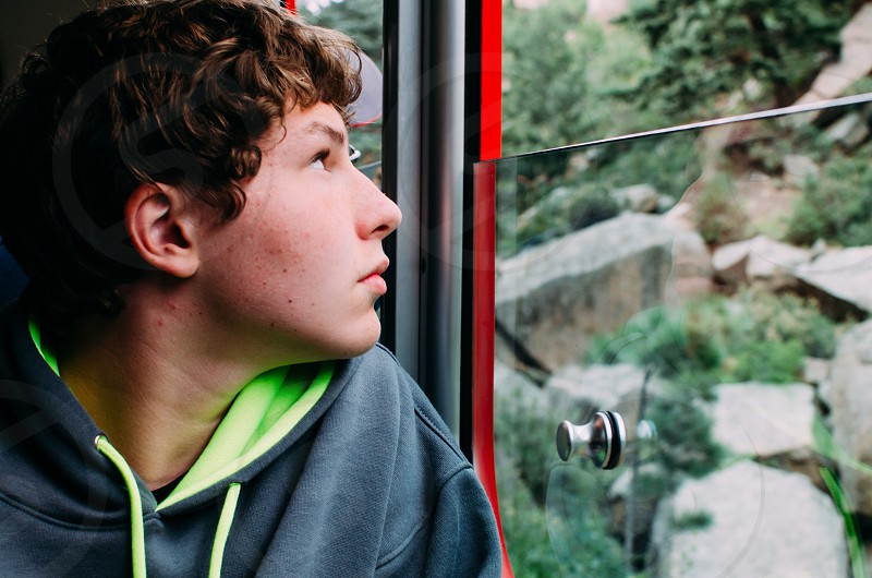 boys grey and green hoodie photo