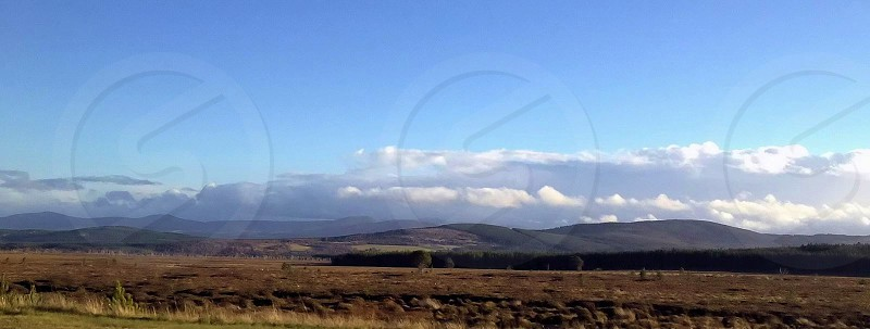 Panoramic view of farming land in Scotland photo