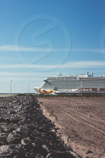 Cruise liner in the port near the beach summer photo