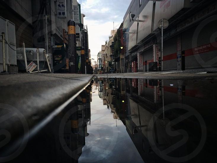 asphalt road between stores photo