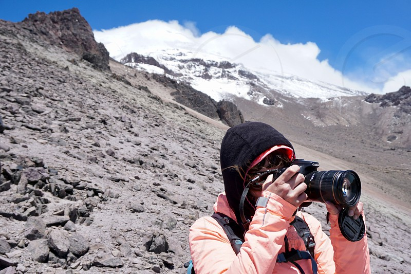 Capturing a photographer at work in a high altitude setting. photo
