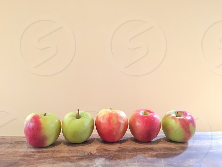 5 green and red apples photo