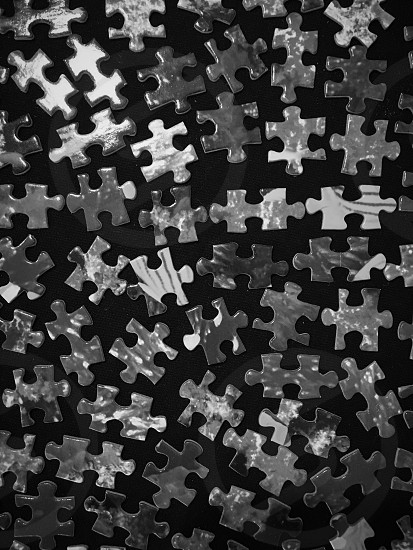 Puzzle pieces in black and white  photo