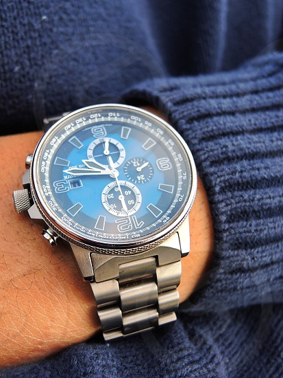 men's blue and silver chronograph watch photo