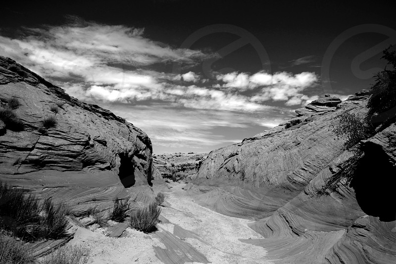 Watering Hole Canyon Sand Arizona Slit Canyons Mountains Sky Clouds Black and White Nature Natural Places Hiking Gods Creations Earth Outdoors American Southwest Southwest USA photo