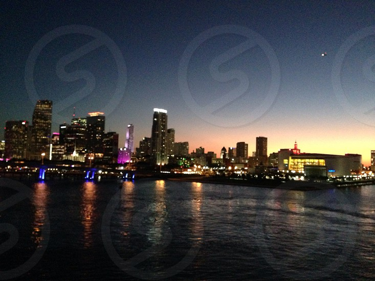 cityscape by water during night time photo