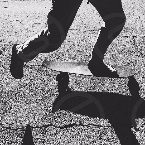 man riding skateboard photo
