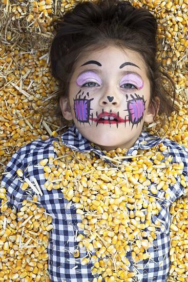 Halloween; kid; kids; child; children; costume; October; fall; autumn; corn; straw; hay photo