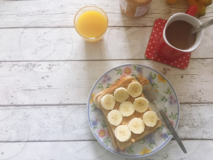 Peanut butter and banana toast with coffee  photo