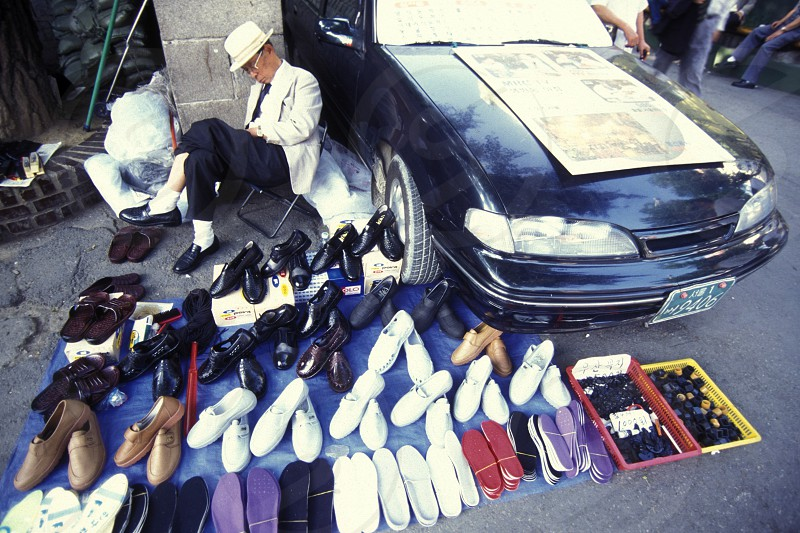 a shoe shop on a market in the city of Seoul in South Korea in EastAasia.  Southkorea Seoul May 2006 photo