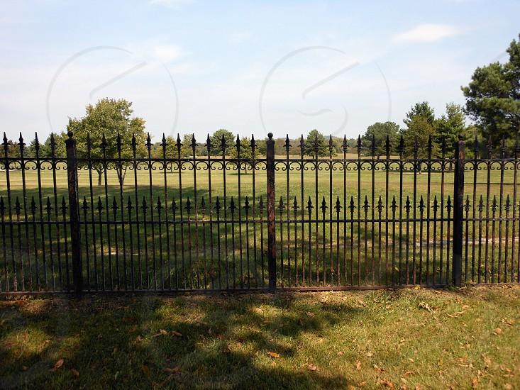 brown metal fence photo
