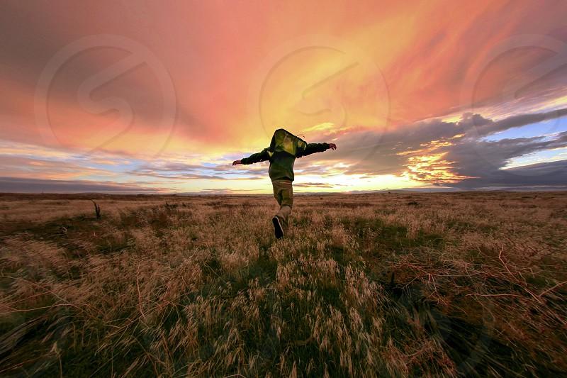 Running into the golden sunset  photo