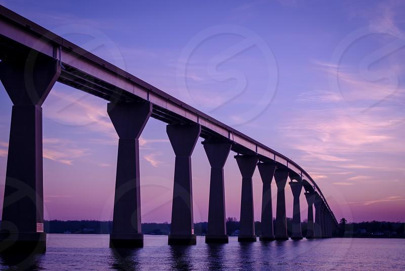 bridge sunset night purple clouds landscape sky water photo
