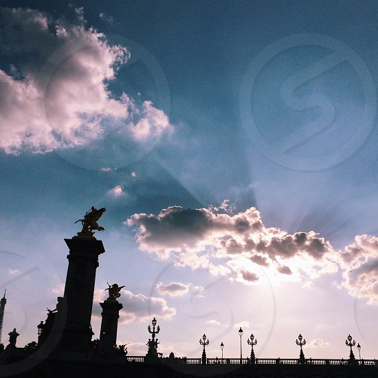 statue and white clouds photo
