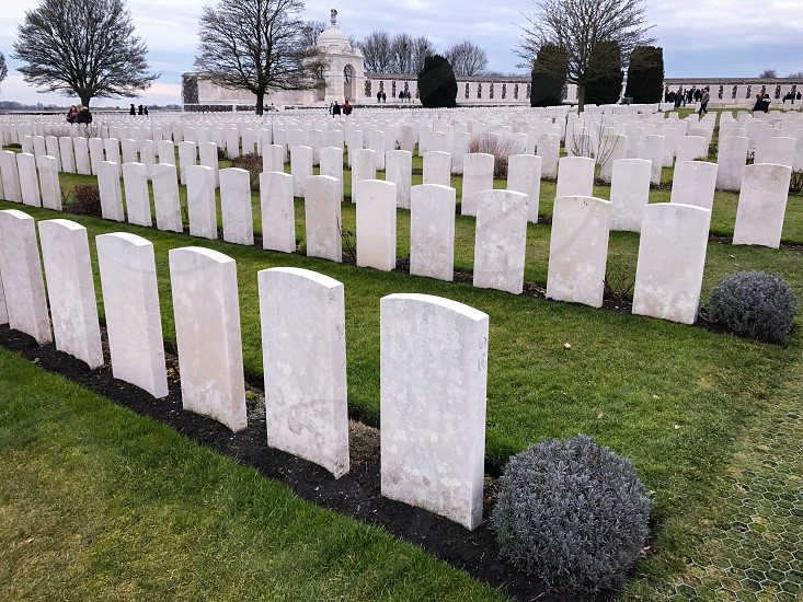 Outdoor day landscape horizontal colour Tyne Cot Cemetery Allied British Commonwealth graveyard graves gravestones memorial War remembrance white marble stone carved grass fields poppies countryside Ypres salient Europe European fields sky nature rest peace beauty silence photo