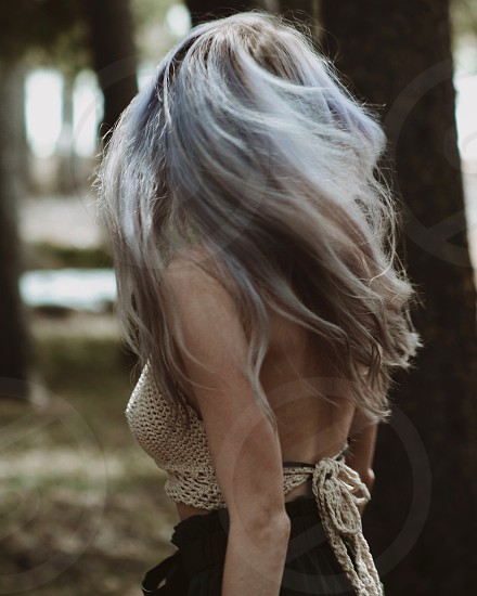 Moody mysterious tranquil calm girl woods pastel hair boho aesthetic deep mountain crochet top beautiful woman serene sultry quiet beauty powerful  photo