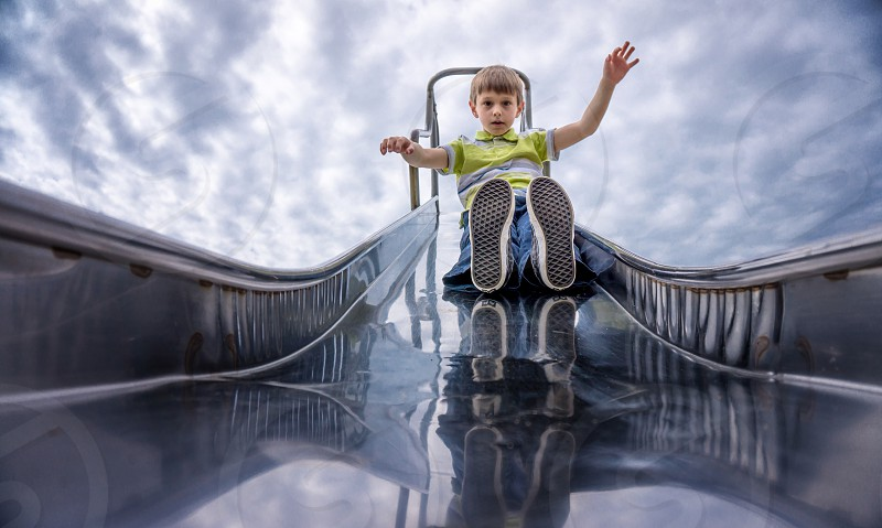 boy playing on the slide photo