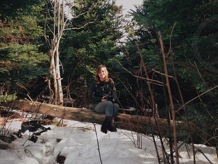 Girl sitting snow forest winter photo