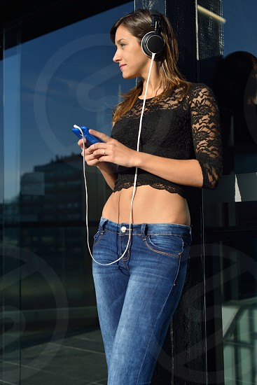 Young woman listening to music on her smartphone photo