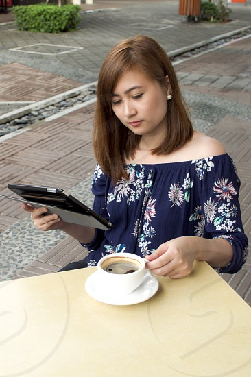 Woman watching video in digital tablet photo