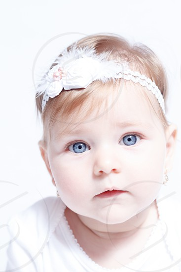 Beautiful little baby girl blue eyes photo