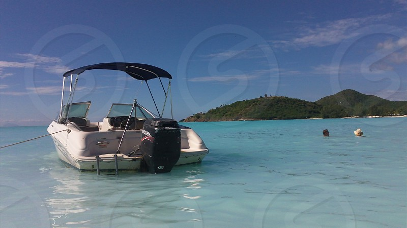 Swimming  people summertime beach vacations caribbean tropical waves sand ocean fun day activities active sportsboat sailing blue waters mountains  photo