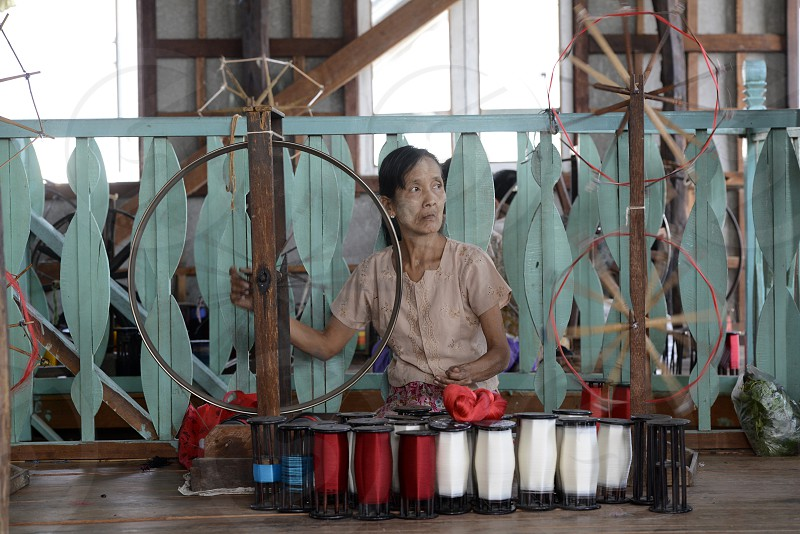 a women in a traditional weaving workshop Factory near the Village of Phaung Daw Oo at the Inle Lake in the Shan State in the east of Myanmar in Southeastasia. photo