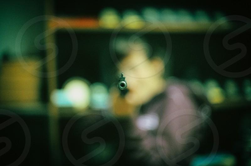 girl rifle gunpoint aim minimalism photo