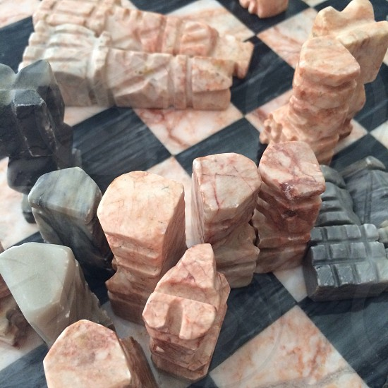 Chess board; chess pieces; marble photo