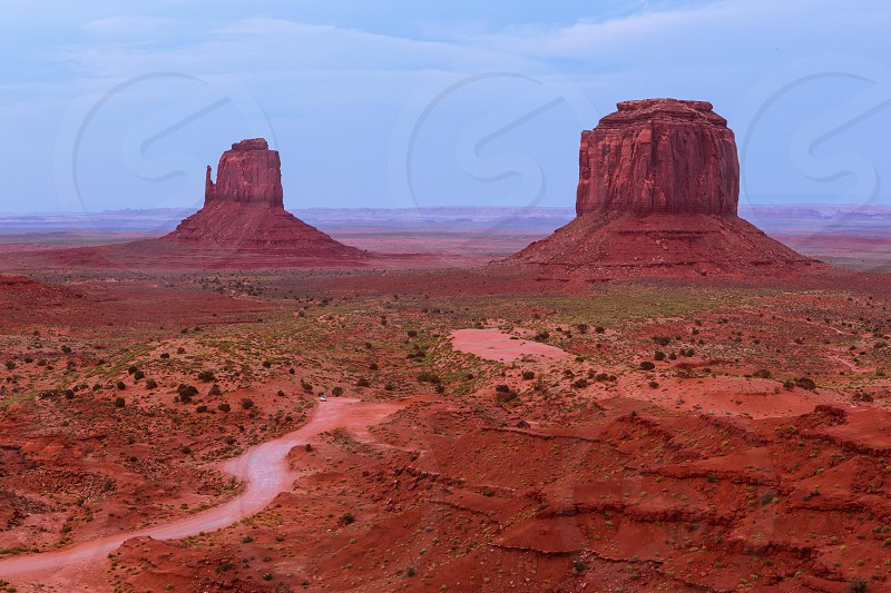 A wide shot of Monument Valley just after sunset. photo