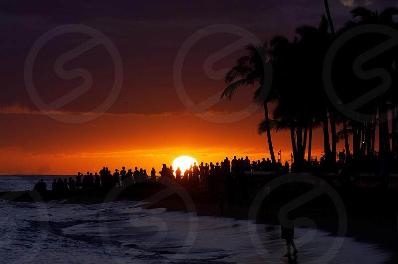 View of sunset revelers photo
