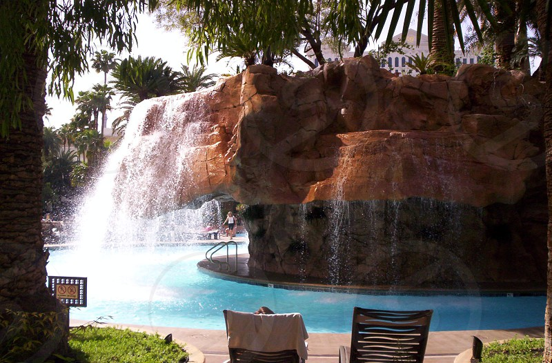 brown rock formation with water feature photo