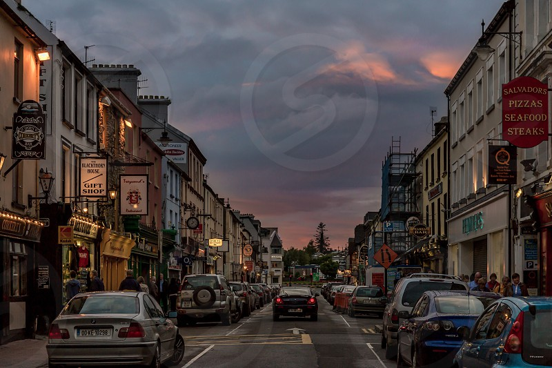 "Killarney (Irish: Cill Airne meaning ""church of sloes"") is a medium sized town in County Kerry southwestern Ireland. The town is on the northeastern shore of Lough Leane which is part of Killarney National Park. photo"