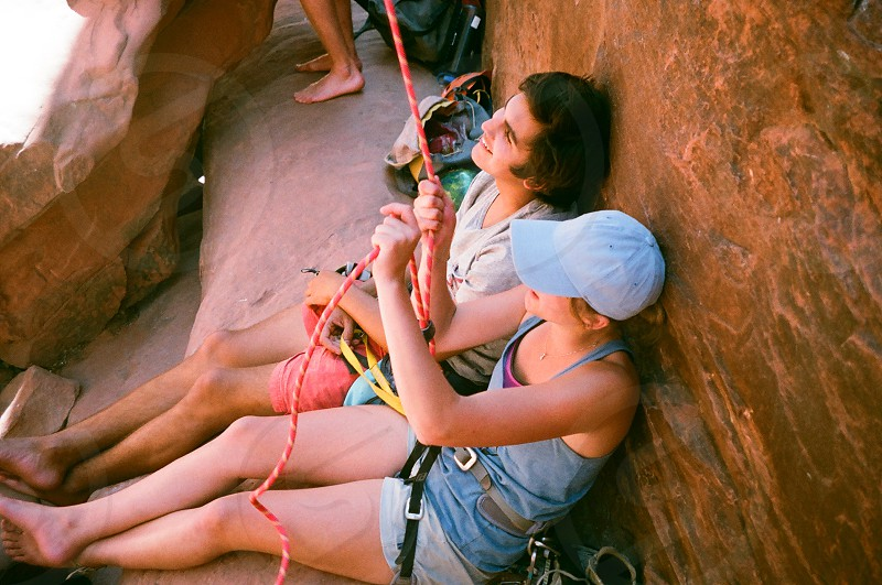 Two friends in Red Rocks NE belaying a climber. photo