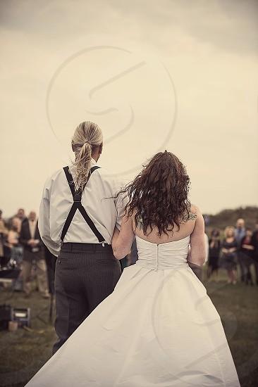 bride walking on isle  photo