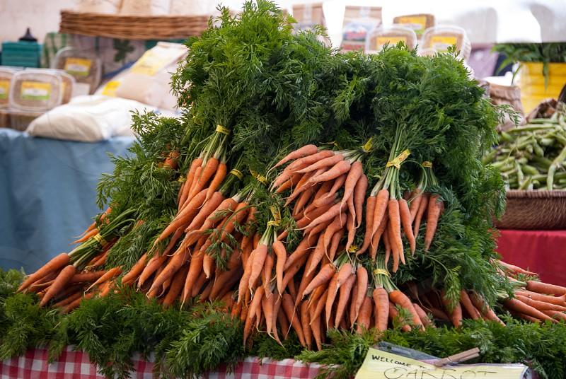 Carrots bunch vegetables farmers market fruit stand organic root crop green orange food fresh photo