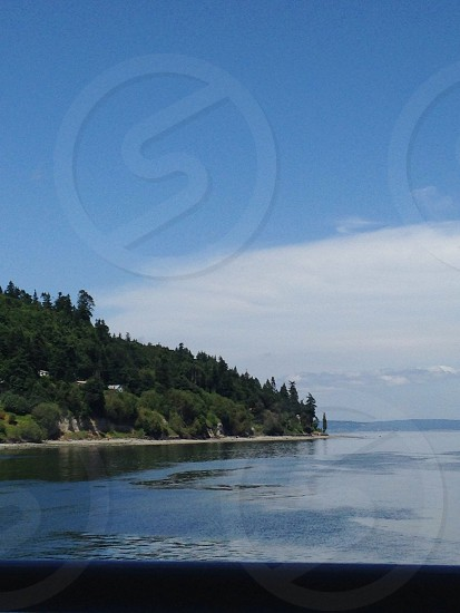 photography of an island near bodies of water during daytime photo