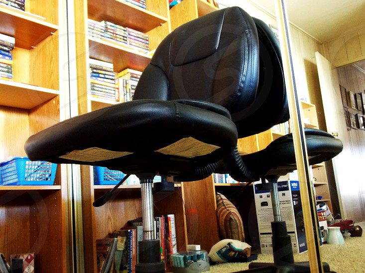 black leather padded swivel chair photo