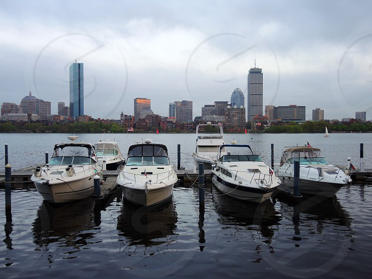4 motor boat on the dock at daytime photo