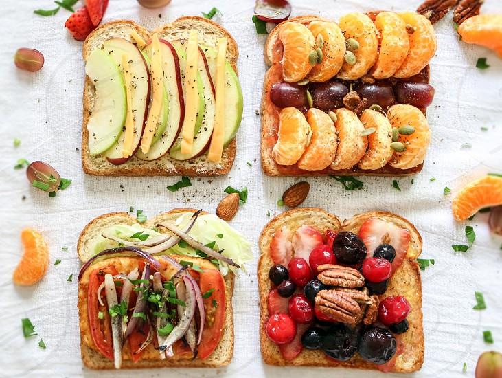 Breakfast time... whole wheat breadfruitsnutssaladsbread toastshealthy breakfasttasty  photo