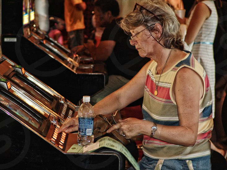 woman playing arcade game photo