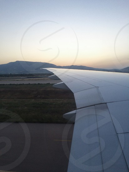 Airplane wing sunset mountain mountains  photo