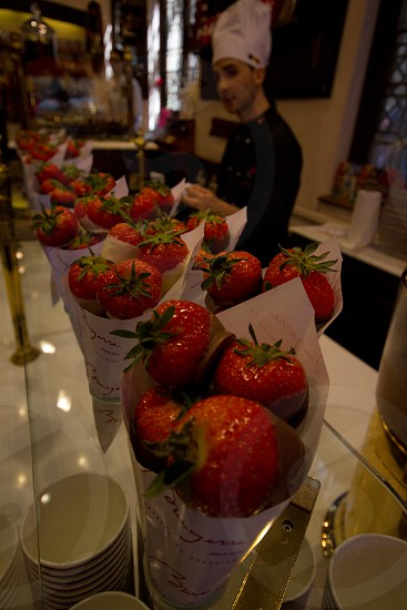 Allot of delicous chocolate strawberries. photo