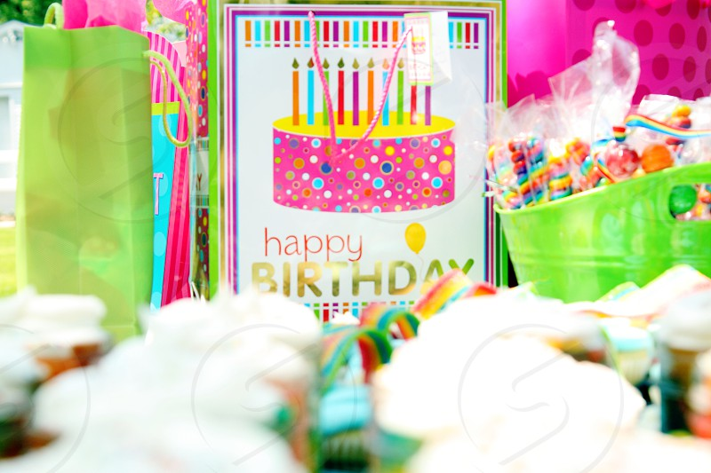 birthday bright pink green rainbow girl celebration cake candles bags frosting cupcakes  photo