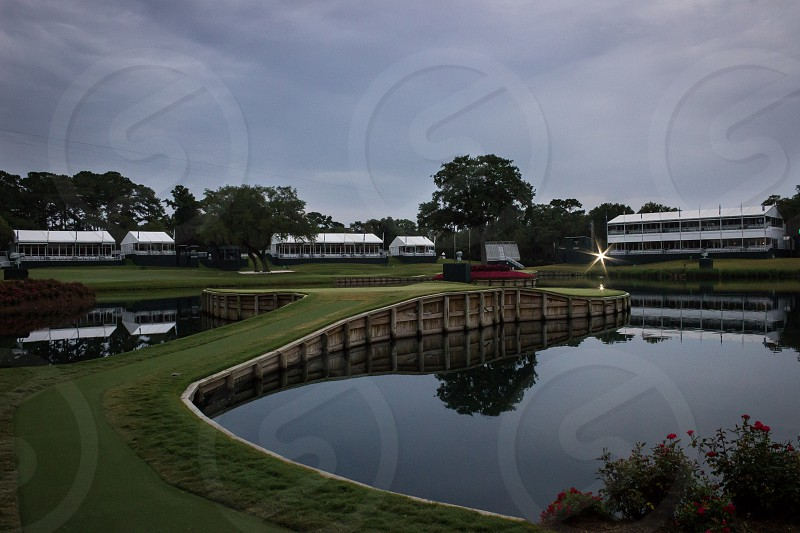 17th hole golf TPC Sawgrass Florida Jacksonville reflection morning water. photo
