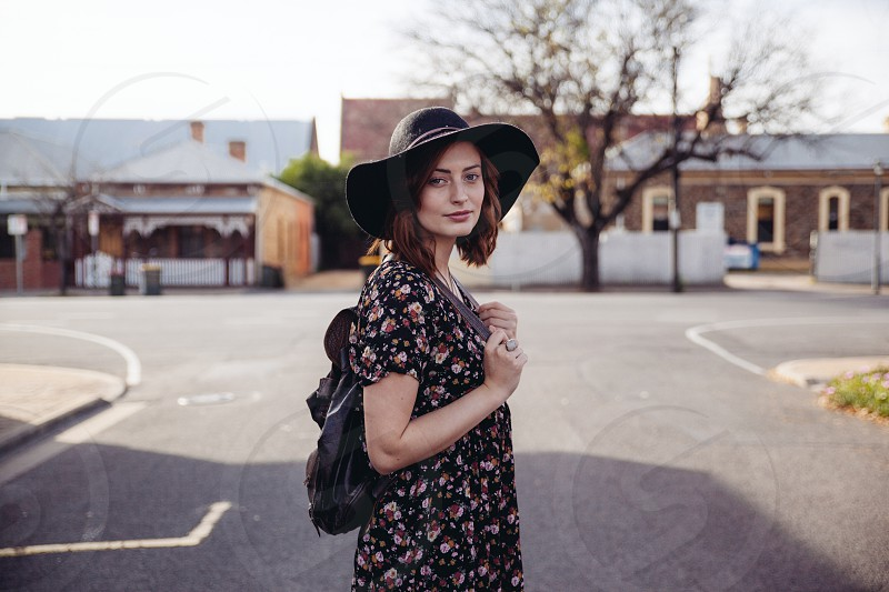Girl with hat and backpack photo