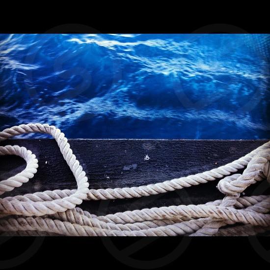 white rope on black wood plank photo