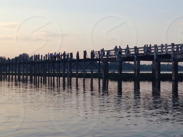 people on the wooden bridge photo