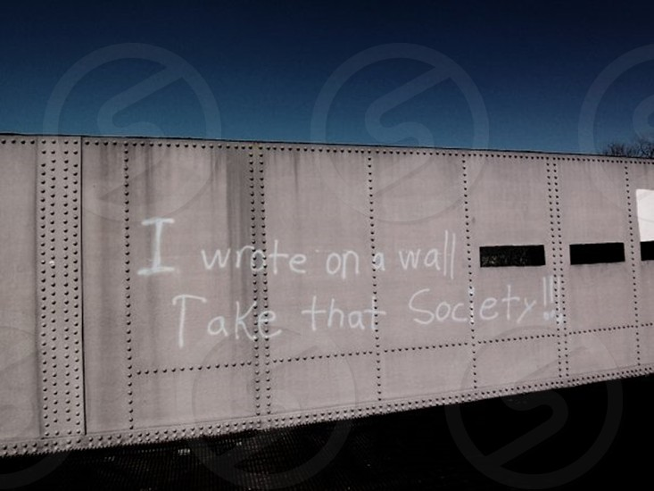 i wrote on a wall take that society!! printed wall photo